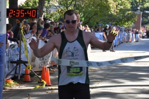 Neal crossing the finish line
